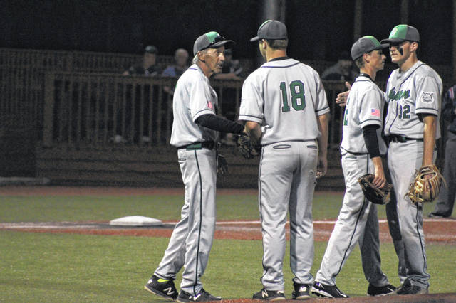 Green head coach Danny McDavid stands at the pitchers mound with his three seniors during Tuesday's loss to Southern: Tayte Carver, Bryce Ponn, and Tanner Kimbler.