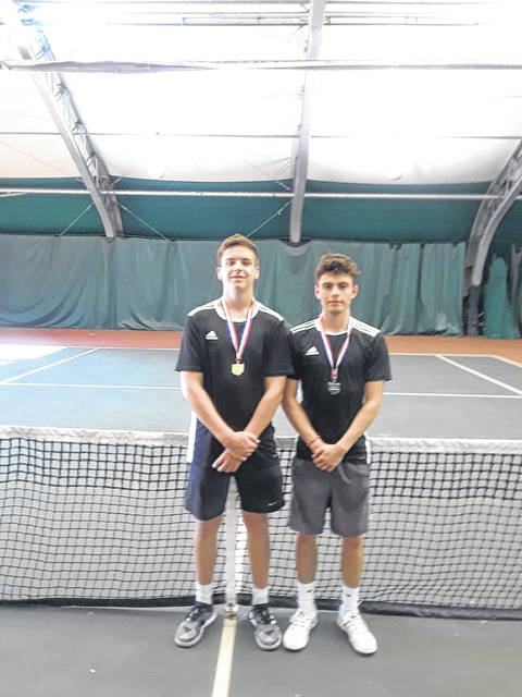 Waverly's Penn Morrison (left) and Brandon Nibert (right) will advance to this weekend's state tennis tournament in Mason, Ohio following their district title Saturday in Athens.
