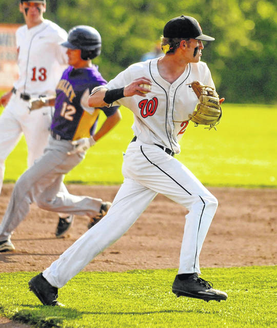 Wheelersburg shortstop Connor Mullins throws a runner out during the first inning of Tuesday's 11-1 win over Valley.