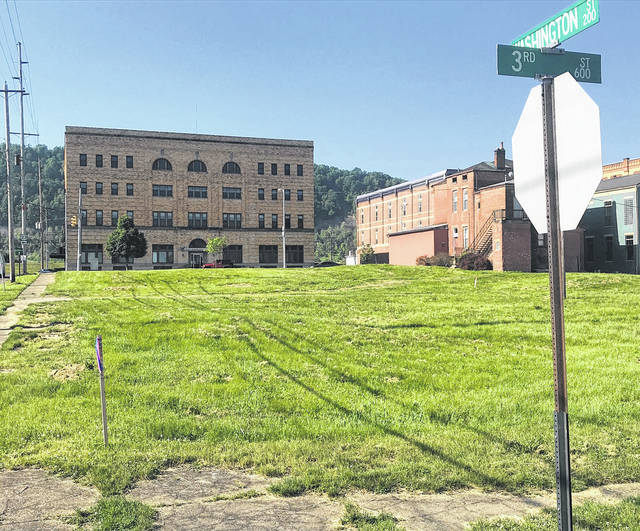 This vacant lot at Washington and Third streets is about to become the site of a seven-story hotel.