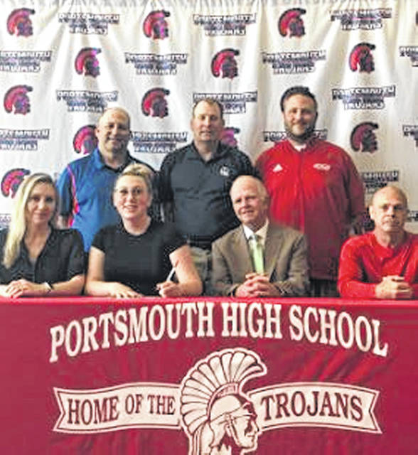 Portsmouth senior Katelyn Pertuset signed her letter of intent Thursday afternoon to join the Shawnee State University women's golf team. Front row L-R: mother Jeanne McGinnis, Pertuset, father James McGinnis, Portsmouth golf coach Buck Whitely. Back row L-R: athletic director Joe Albrecht, Shawnee State coach David Hopkins, Assistant AD Jason Vandeusen.
