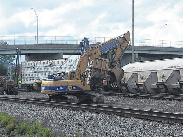 Crews began work Thursday afternoon to clear the Norfolk Southern Railroad tracks at the entrance of the rail yard in Portsmouth. Four cars derailed Thursday morning. No injuries were reported.