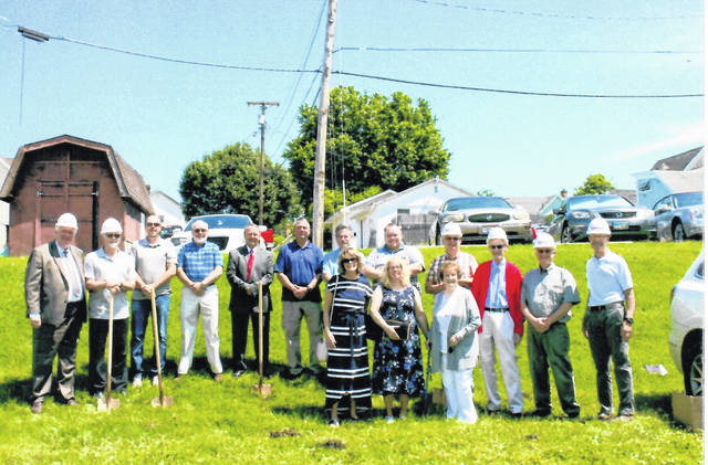 Pastor Dennis Dawes with his church officials ready to break ground for their new church building on Sunday.