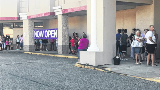 A fairly long line of people lined up outside the new Gordmans store Thursday.