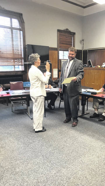 Charlotte Gordon was sworn in Tuesday evening to represent Portsmouth's 2nd Ward on city council. Swearing in Gordon is City Solicitor John Haas.