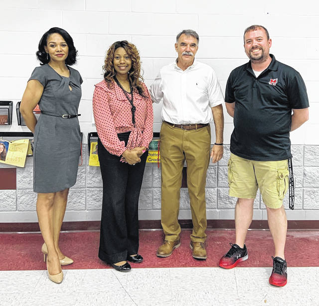 (left to right) Tia Ramey and Michele Reynolds from the Governor's office, Mark Hunter, and Superintendent of Minford Local Schools, Jeremy Litteral.