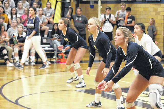 Notre Dame's Sophia Hassel (far right) is returning from a second ACL tear this fall. After helping the Titans win 21 games as a junior, she's hoping for more success as she closes out her volleyball career.