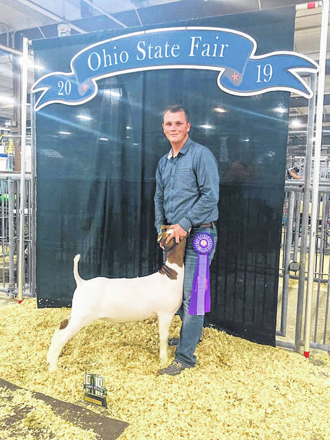 Talen Coriell of Minford, won the 18-year-old Showmanship Champion with his goat at the Ohio State Fair.