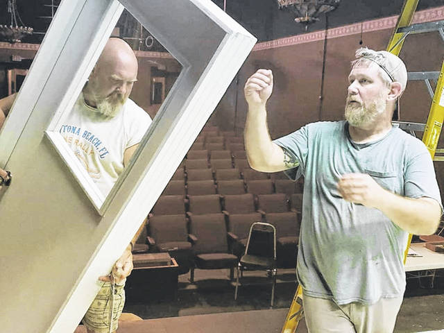 Jim Humphrey and Marc Scott preparing the stage for The Humans.