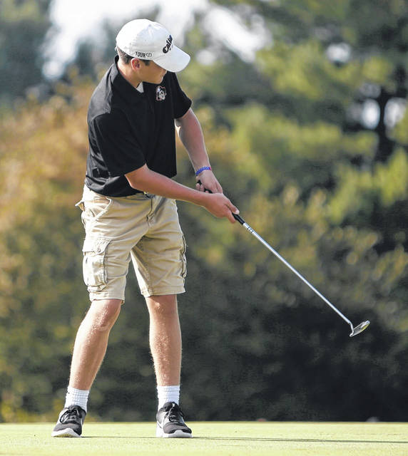 Wheelersburg's Cooper McKenzie strokes a putt during the Pirates first match of the year Tuesday morning.