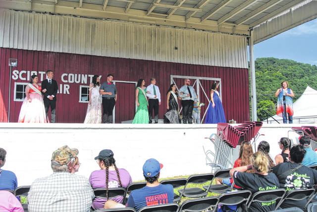 Contestants await the announcement of fair queen.
