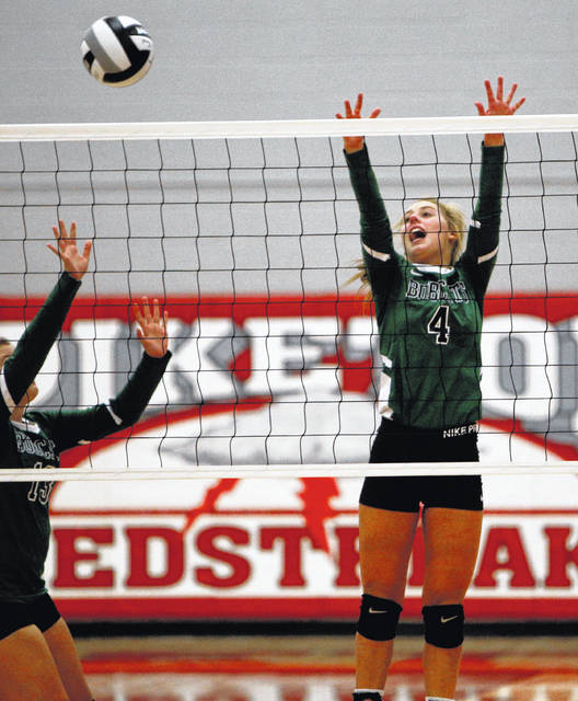 Green sophomore Kasey Kimbler attempts to block a ball at the net during Thursday's loss to Piketon. The Bobcats fell victim to a 25-12, 25-12, 25-19 sweep.