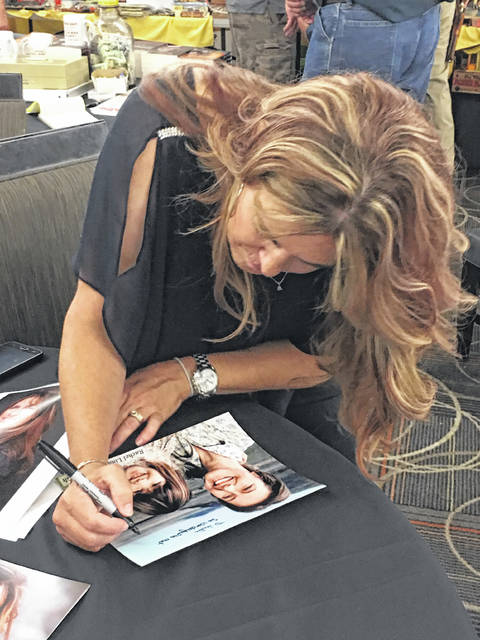 Rachel Lindsay Greenbush signing autographs at the Roy Rogers Festival. Greenbush played Carrie Ingals on Little House on the Prairie as a child.