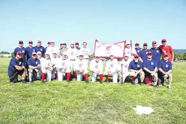 Members from the 1869 Cincinnati Red Stockings vintage baseball team pose for a photo alongside the Portsmouth Pick 9 team which consisted of local citizens.