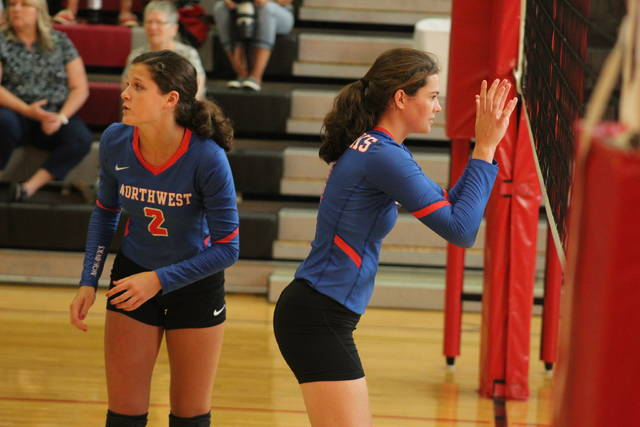 Haidyn Wamsley (right) and Reagan Lewis (left) await the Mohawks serve during their victory over New Boston Monday night.