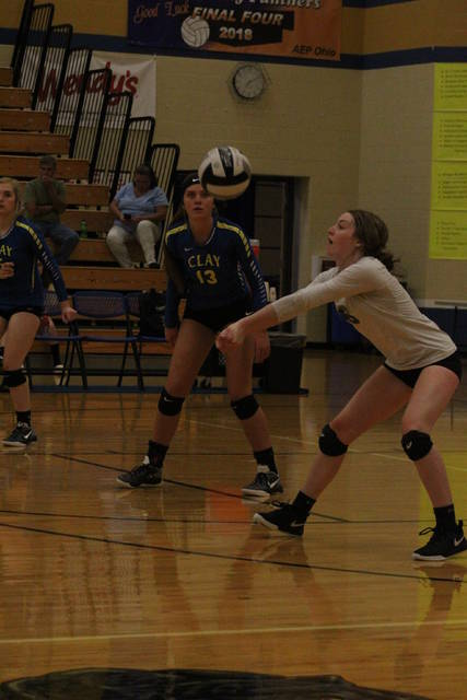Clay libero Kyleigh Oliver attempts a dig during the Panthers season opening loss to North Adams Monday night.