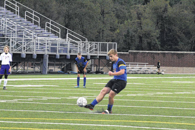 Clay's Bryce Toomire attempts a penalty kick during last year's sectional game vs. Valley.