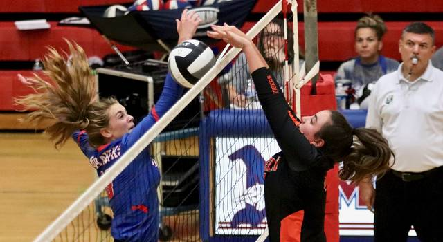 Northwest sophomore Ava Jenkins battles with Waverly's Hailie Silcott at the net Monday evening at Northwest High School. The Mohawks dropped their first decision this season in a four-set loss to the Tigers.