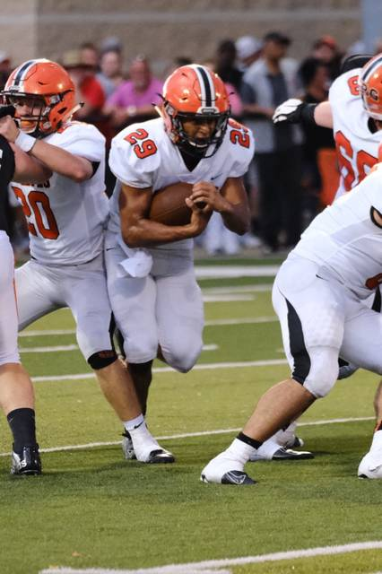 Wheelersburg senior Makya Matthews with a carry in the early stages of the Pirates season opening loss to Ironton Friday night.