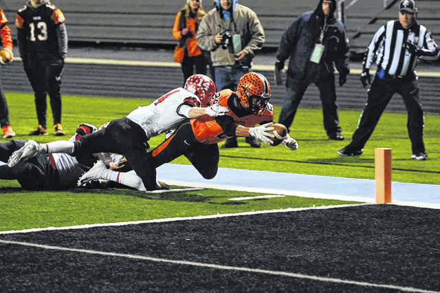 Wheelersburg senior Makya Matthews dives for the end zone during the Pirates postseason game against Madison a year ago.