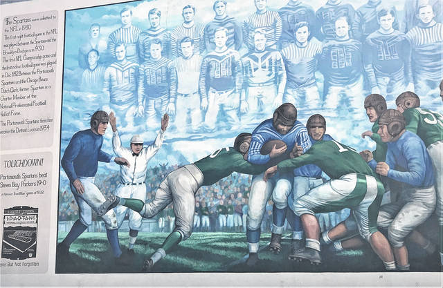 Flood wall mural depicting Presnell going in to score during the Ironman game against the Packers.