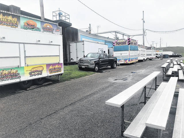 Despite some rainy weather, which surely will disappear by the weekend, vendors began Tuesday to set up their River Days concession stands near the River Days stage.