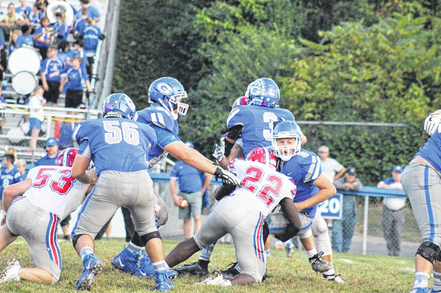 Portsmouth sophomore Alberto Poxes sacks Gallia Academy quarterback Noah Vanco during the Trojans road loss to the Blue Devils Friday in Gallipolis.