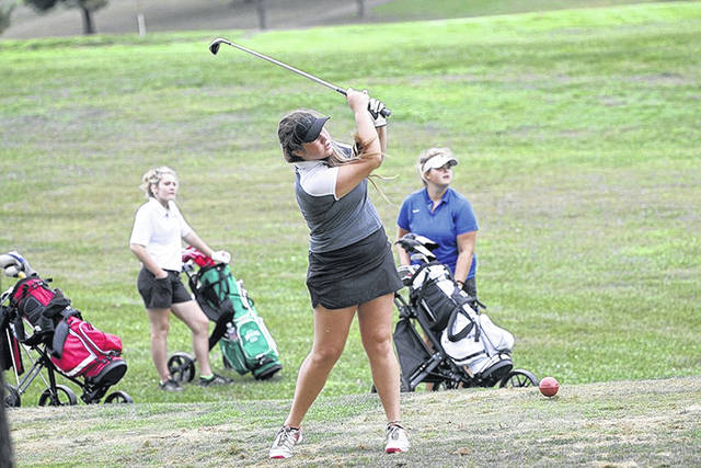 Minford's Annie Lawson attempts a shot during the Division II girls golf sectional at Franklin Valley golf course in Jackson Monday.