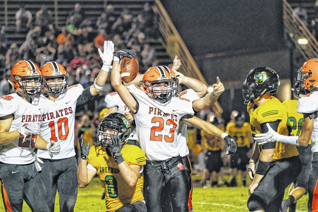 Wheelersburg's Eli Swords celebrates after recovering a Greenup County fumble in the Pirates road trip to 'The Farm' Friday.