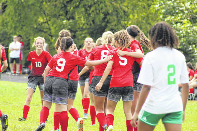 Minford freshman Haley Knore (5) is greeted by teammates after her go-ahead goal in the Falcons win over Fairland Saturday.