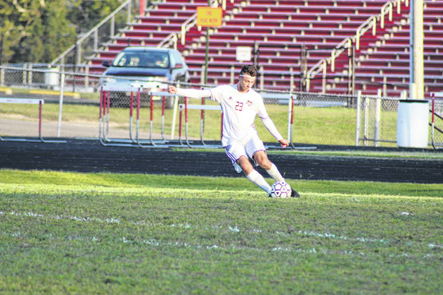 Valley senior Christian Petry attempts a free kick during the Indians 0-0 tie with Minford Tuesday