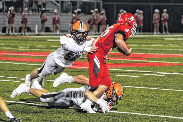 Wheelersburg senior Kaleb Johnson reaches out his arms to pull down a Jackson ball carrier during the Pirates trip to Alumni Stadium Friday.