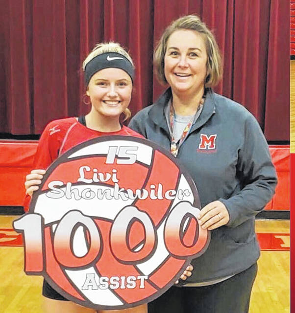 Minford junior setter Livi Shonkwiler recorded her 1,000th career assist during the Minford Falcons varsity volleyball game against Northwest Wednesday night. Prior to the Falcons game at home against Oak Hill, Shonkwiler was honored by her coaches and teammates for the accomplishment. Minford defeated Oak Hill in a straight set sweep in SOC II play.