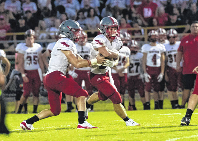 Minford's Ty Wiget (right) and Elijah Vogelsong-Lewis (left) combined for over 400 yards rushing during the Falcons 45-27 win over Greenup County Friday night in Lloyd.