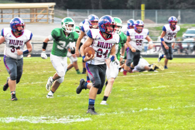 Northwest junior Nathan Rivers gets into the open field during the Mohawks road win at Huntington Friday.