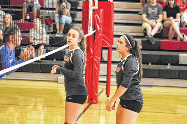 New Boston's Kenzie Whitley and Sammy Oiler prepare for action in a Tigers volleyball match earlier this fall.