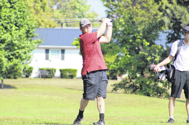 South Webster's Nick Smith strikes a ball during the Division III southeast district golf tournament Monday morning at the Elks Country Club in McDermott. Smith, Andrew Smith, Gavin Baker, Cam Carpenter, and Riley Burnett qualified for the district golf tournament as a team by placing second at their sectional meet last Wednesday at Franklin Valley Golf Club near Jackson. Check out the <em>Portsmouth Daily Times Sports </em>Facebook page for more pictures of Monday's district tournament and keep an eye out for a full recap of Monday's tournament as soon as results become available on https://www.portsmouth-dailytimes.com/category/sports.