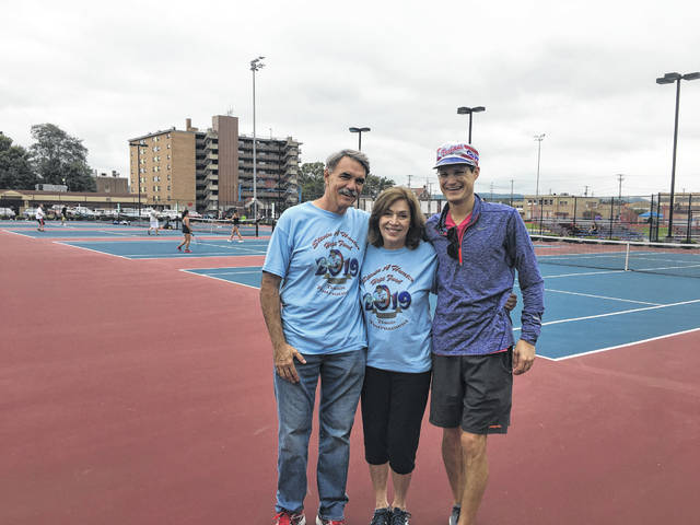 Mark and Virgie Hunter, along with Tournament Co-Coordinator Taylor Babcock at the Steven Hunter Memorial Tennis Tournament Saturday.