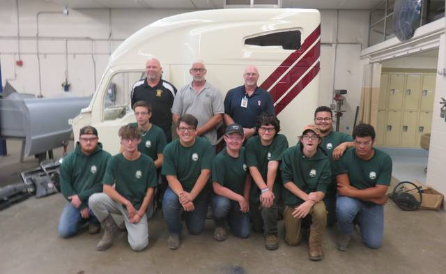 Kenworth cab that was donated to the SCCTC. Back Row (Left to Right): Matt Rann,-Principal SCCTC, Eli Riggs-AutoBody Instructor, Tracy DePugh-Kenworth. Seniors from the AutoBody Class: Front Row (L to R): Noah Osborne, Creed Parker, Chad Blackburn, Garrett Humphrey, Brice Slusher, Shaun May, Brad Sedgwick, Trenton Johnson, and Noah Stevens Absent: William Robinson and Noah Cameron