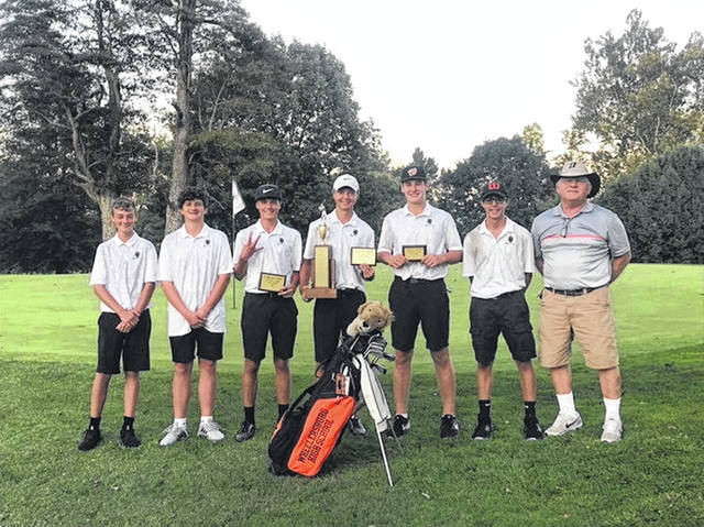 (Left to right) Wheelersburg's Levi Kidd, Aizik Bowen, Trevin Mault, Tanner Stevenson, Cooper McKenzie, Alex Thomas, and coach Paul Boll pose for a picture following the Pirates victory at the 2019 SOC Golf Championships Tuesday at the Elks CC in McDermott.