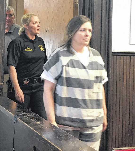 Still wearing jail garb, Angela Wagner walked into a Pike County courtroom in July.