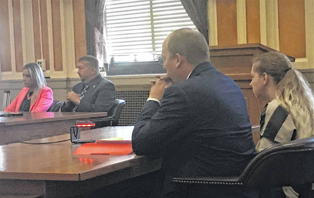 At a hearing Tuesday, Jessica Groves, far right, sits next to court appointed attorney Robert Stratton. Scioto County Prosecutor Shane Tieman and Assistant Prosecutor Julie Dawn Hutchinson sit at the second table.