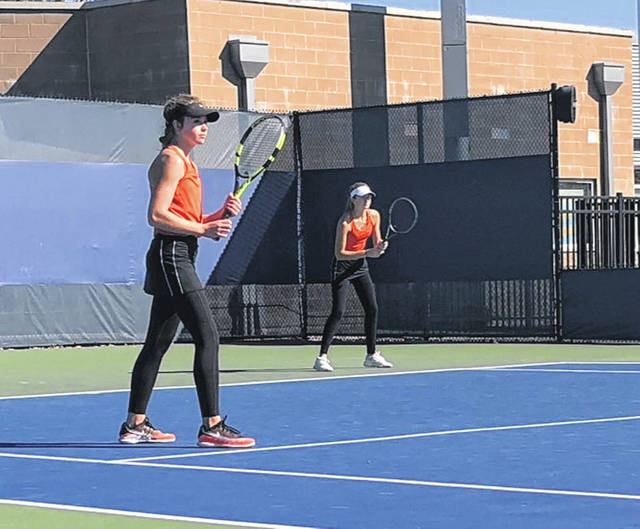 Wheelersburg junior Maddie Gill (left) and senior Kaitlyn Sommer (right) compete in the Division II doubles of the annual girls state tennis tournament on Friday at the Lindner Family Tennis Center.