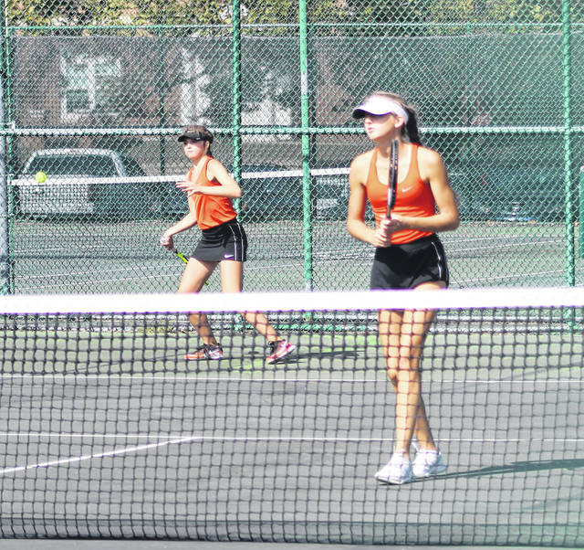 Wheelersburg senior Kaitlyn Sommer (foreground) and junior Maddie Gill (background) compete in the championship match of the Division II Southeast-East District girls tennis tournament last Wednesday at Ohio University in Athens.