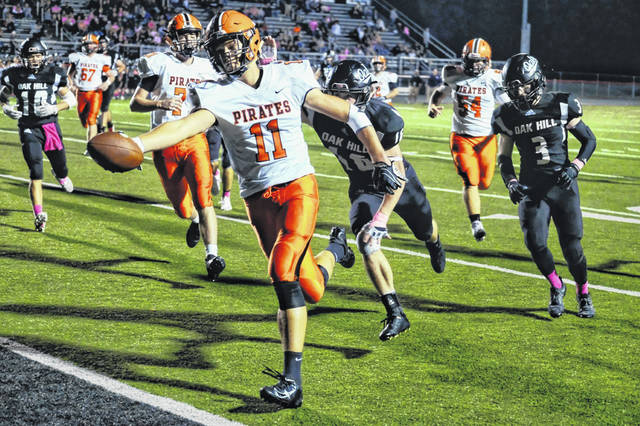 Wheelersburg senior Corey Maxie scored two touchdowns, including this 17-yard touchdown rush, in the Pirates road win over Oak Hill, Friday.