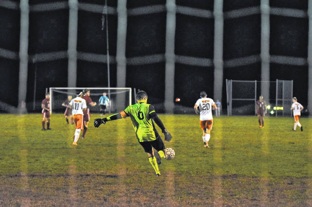 Wheelersburg goalie Eric Green boots the ball downfield during his Pirates SOC II title clinching road win over Minford, Thursday.