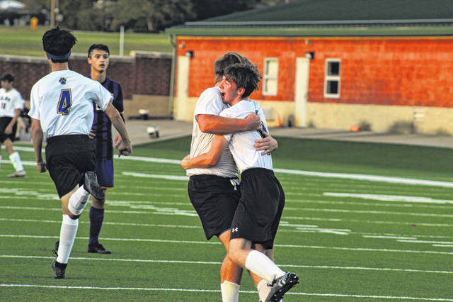Clay junior Corvan Clark (right) embraces senior Bryce Toomire (left) after scoring his first career goal in the Panthers 1-0 win over Valley, Thursday.