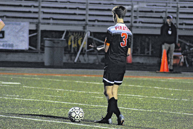 Wheelersburg's Aaron Jolly lines up for a free kick during the Pirates district semifinal win over Valley, Saturday.