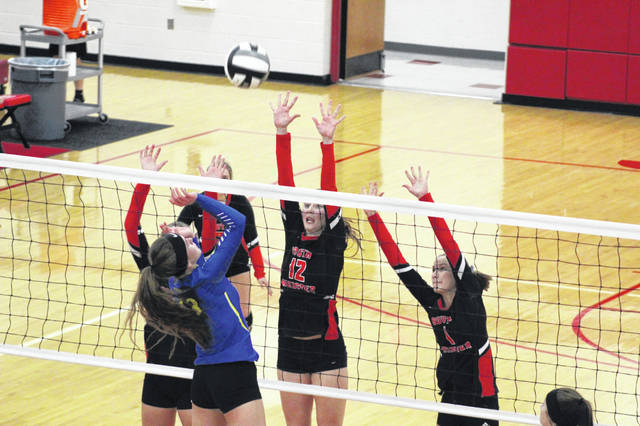 South Webster sophomore and District 14 player of the year Faith Maloney attempts a block during the Jeeps district semifinal win over defending district champion Clay.