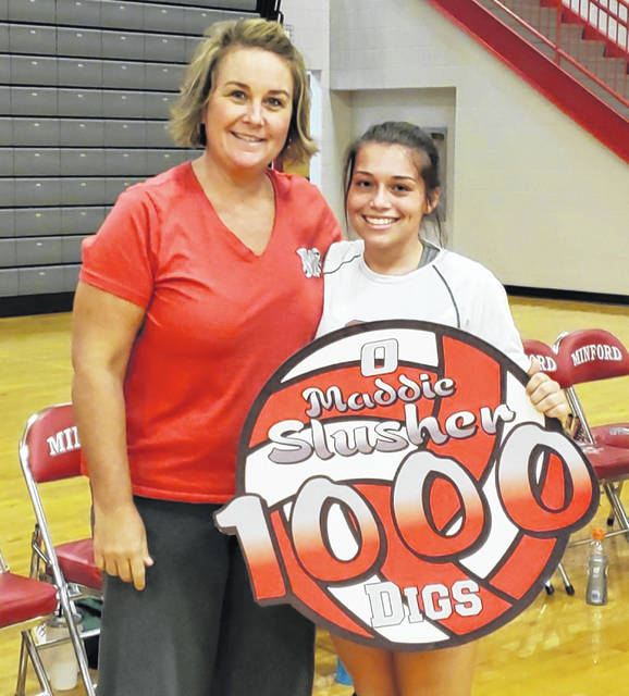 Minford senior libero Maddie Slusher recorded her 1,000th career dig during the Falcons home game vs. South Webster Thursday night. Slusher was recognized during Thursday's game for her outstanding accomplishment. Pictured with Slusher is Falcons coach Rachael Stapleton.